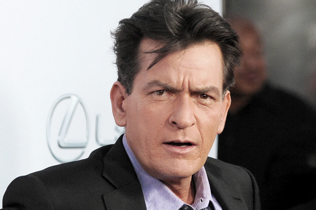 "Charlie Sheen, a cast member in ""Scary Movie V,"" poses at the Los Angeles premiere of the film at the Cinerama Dome on Thursday, April 11, 2013 in Los Angeles. (Photo by Chris Pizzello/Invision/AP)"